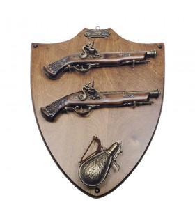La panoplie de bois avec des armes et des polvorera